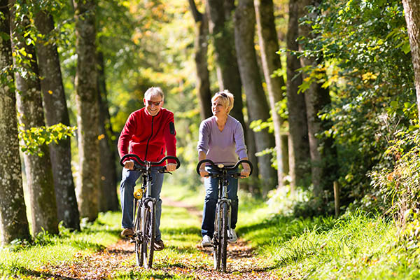 retired couple biking