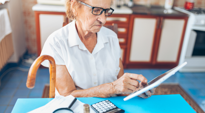 senior woman checking her finances and QFZBVNC 1 1