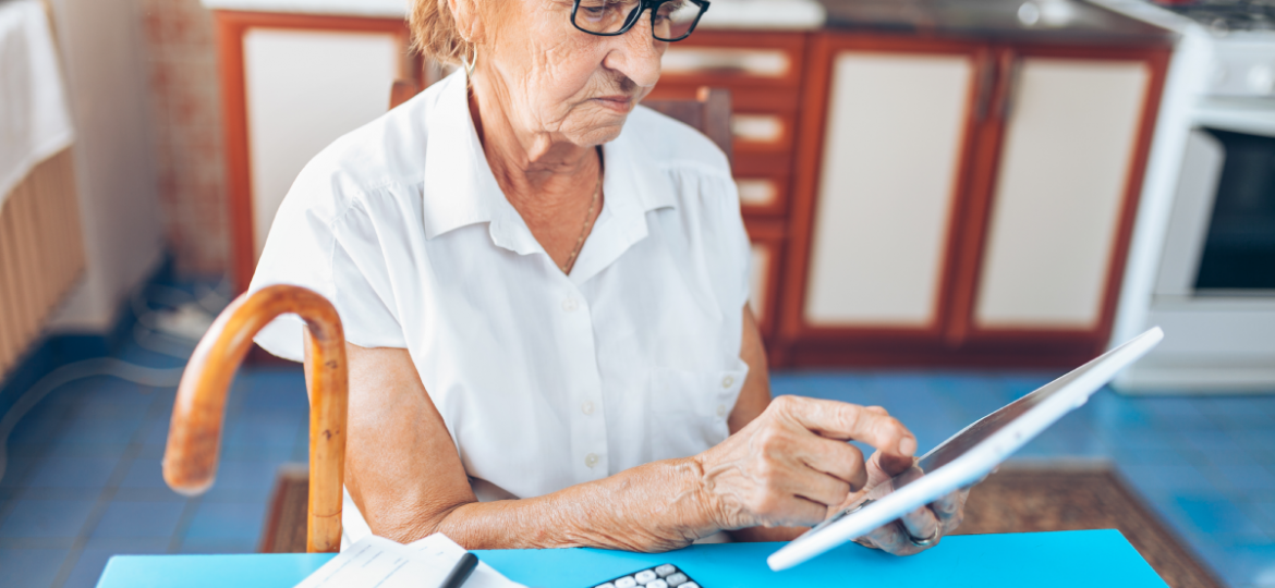 senior-woman-checking-her-finances-and-QFZBVNC-1.png