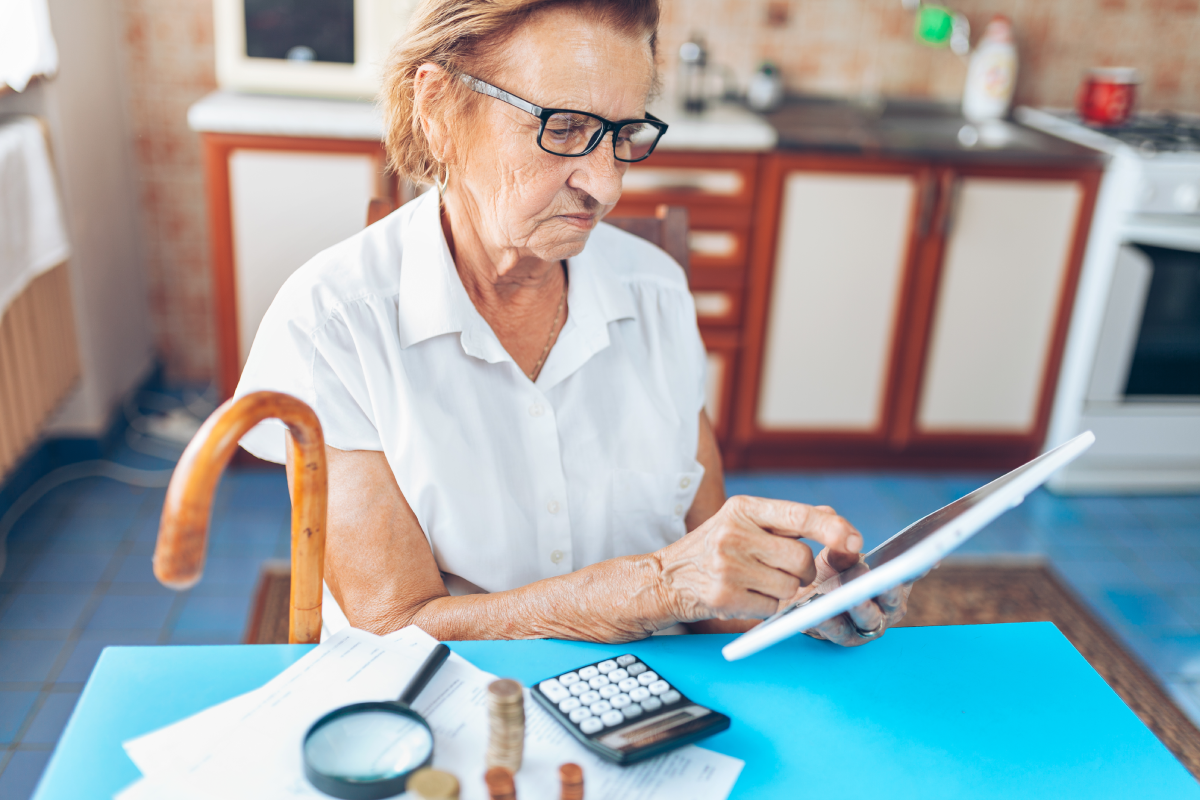 senior woman checking her finances and QFZBVNC 1